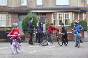 Adults-chatting-children-cycling